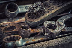 Old rusty tools in the workshop. On an old wooden table royalty free stock photos