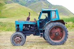 Old rusty tractor. On grass Stock Photos