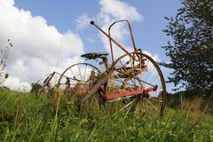 Rusty tractor, combine harvester on a meadow, a field royalty free stock photos