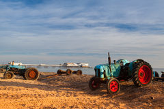 Old rusty tractor on the Cromer beach,Great Britain Royalty Free Stock Photo