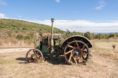 Old rusty tractor in a field Royalty Free Stock Image