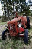 Old rusty tractor in the forest Royalty Free Stock Photos