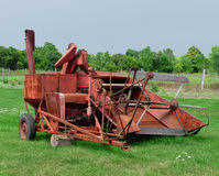 Old rusty tractor pulled combine Royalty Free Stock Photos