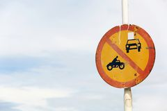Old rusty traffic sign on byroad. Old rusty traffic sign forbids motor vehicle on road Royalty Free Stock Image