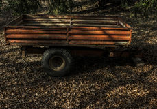 Old rusty trailer in the woods royalty free stock photo