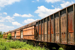 Old Rusty Train Cars Curving Stock Photo