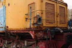 Old rusty train orange and red colors on a street. Stock Photo