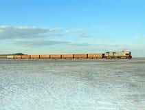 Old rusty train on the salt lake Baskunchaki Royalty Free Stock Photography
