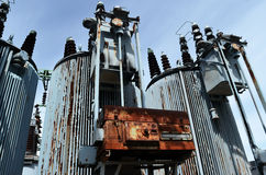 Old rusty transformer substation against the blue sky Stock Photo