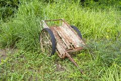 Old rusty trolley is in the grass forest.  Stock Images