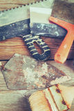 Old rusty trowel, spatula and brush. Tinted. Royalty Free Stock Photography