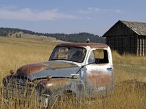 Old Rusty Truck and Building. This image of the old, abandoned rusty pickup truck was taken in western MT Stock Photography