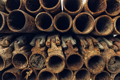 Old rusty used scaffolding pipes on construction site Stock Images