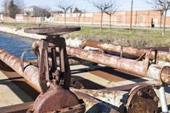 Old rusty valves. And pipeline Stock Image
