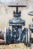 Old rusty valves and tanks Stock Photo