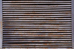 Old rusty ventilation grille. Texture of an old rusty ventilation grille Royalty Free Stock Photography