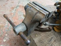 Old vice on wooden base stock photo