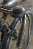 Old rusty vintage bicycle handle and bell. Old rusty vintage bicycle show in the restaurante Royalty Free Stock Photo