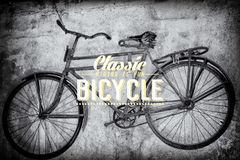 Old rusty vintage bicycle. Near the concrete wall Royalty Free Stock Image