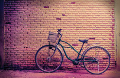 Old rusty vintage bicycle near the concrete wall stock image