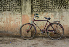 Old rusty vintage bicycle near the concrete wall Royalty Free Stock Photography