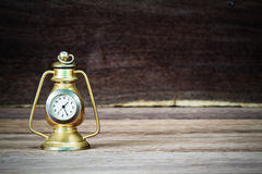 Old rusty vintage classic table golden clock on blurred wooden background Stock Images