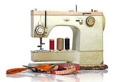 Old Rusty Vintage Sewing Machine with Scissors and Tape Measure Royalty Free Stock Photography