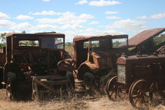 Old rusty vintage trucks. Vintage trucks rusting in field Stock Images