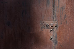 Old rusty wall with door and bolt Royalty Free Stock Images
