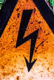 Old rusty warning high voltage sign Royalty Free Stock Images