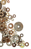 Old rusty washers over white background Royalty Free Stock Image