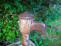 Old rusty water pump in the village. Dirty and rusty water pump stock images