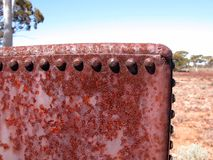 Old rusty water tank for use on a horse drawn wagon. royalty free stock images