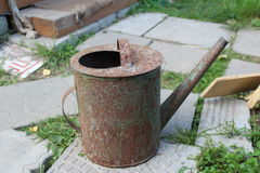 Old rusty watering can Royalty Free Stock Photography