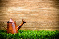 Old and rusty watering can Stock Photos