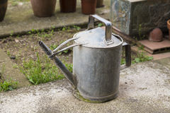 Old and rusty watering can Royalty Free Stock Photography