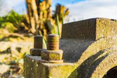 Old rusty waterwheel. Detail shot of a bolt stock images