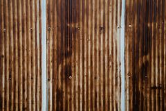 Old rusty wavy metal plate wall. Background Stock Photos