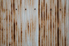 Old rusty wavy metal plate wall. Background Royalty Free Stock Image
