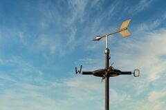 Free Old Rusty Weather Vane Against A Cloudy Blue Sky Royalty Free Stock Images - 172936459