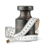 Old rusty weight wrapped centimeter Royalty Free Stock Photography