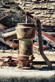 Old rusty well pump Stock Images