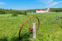 Old rusty wheel. Thrown into the field stock image