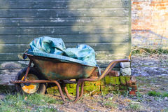 Old rusty wheelbarrow Stock Photo
