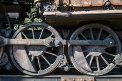 Old rusty wheels of the steam locomotive and the elements of the drive royalty free stock photos