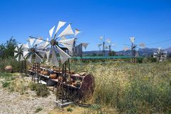 Old rusty windmills on the field. Agriculture in Greece, Crete Royalty Free Stock Photo