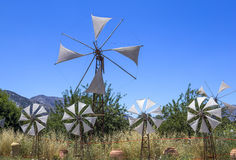 Old rusty windmills on the field. Agriculture in Greece Royalty Free Stock Photography