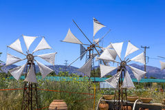 Old rusty windmills on the field. Agriculture in Greece Stock Photo