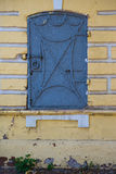 Old rusty window on yellow wall Royalty Free Stock Photography