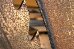 Old rusty wood cutting saw heavy duty macro Stock Images